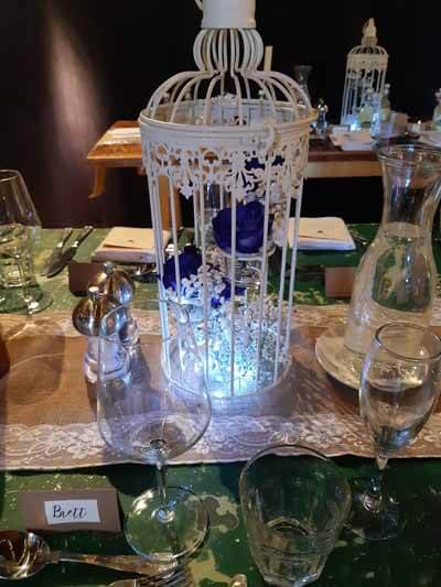 Weddings - Props For Hire - Table Centrepieces - Birdcages - lights and Flowers extra