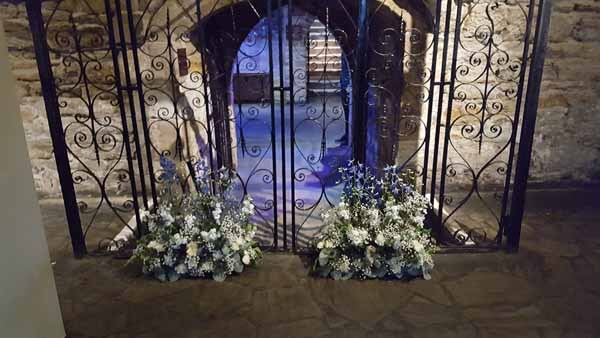 Weddings - Table Arrangements - (Floor) - Vendela Roses, Gyp, Foliage, Blue Delphinium, Ivory, Gerbera, Thistle and White Carnations