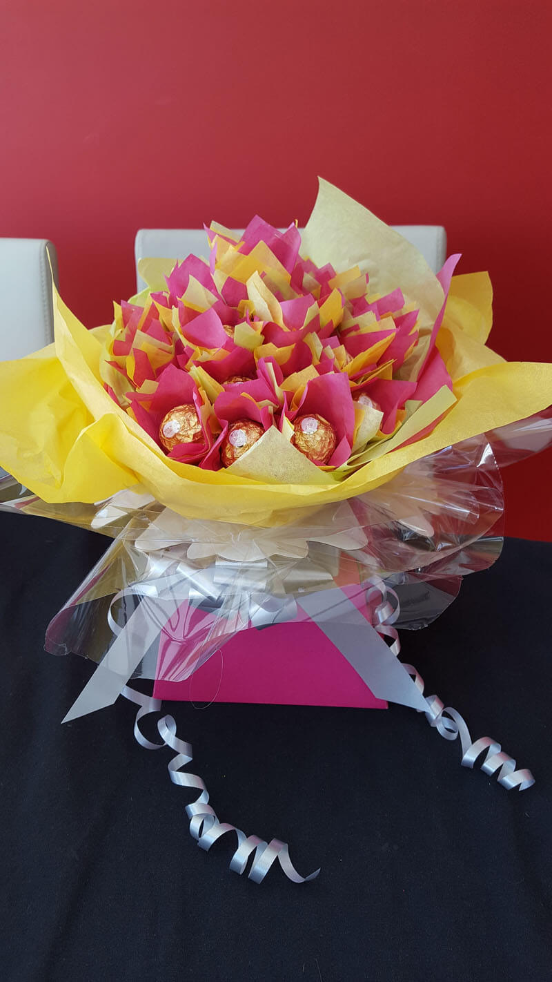 Gifts - Chocolate Roche Bouquet - 25 Chocolates, Bright Pink Box, Silver Ribbon, Yellow lemon & Cerise Tissue & Silver Butterfly