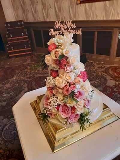Weddings - Cake Flowers Waterfall - Vendela Roses, Spray Roses, Pink Roses, Gyp & Foliage