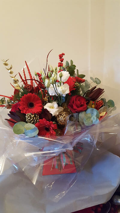 Christmas Bouquets and Arrangements - Christmas Handtie Bouquet - Red Gerbera, Lucadendrum, White Eustoma, Wild Foliage, Gold Acorns, Gold Foliage & Tartan Ribbon, Box