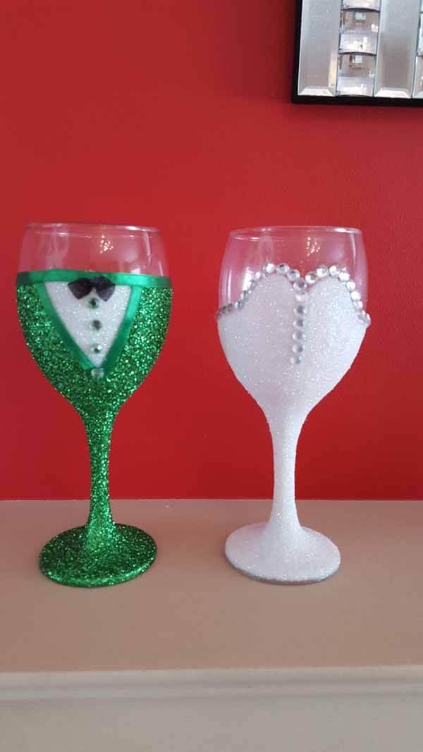 Gifts - Bride & Bridegroom Glass Wine Glasses - Groom: green glitter, White with Black bow & Diamante gems. Bride: White, Diamante edge, shape strapless