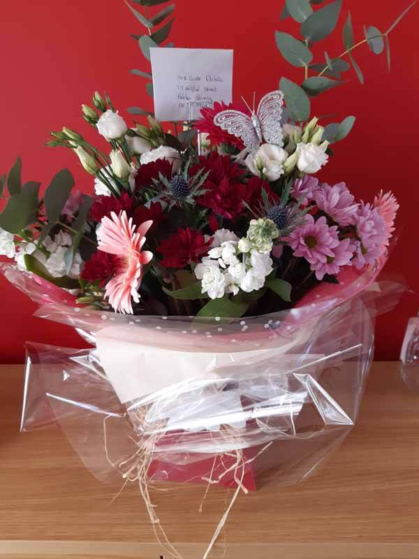 Flower Gift Bouquets and Arrangements - Handtie Bouquet -Handtie Bouquet - chrysanths, Eustoma, carnations, thistle, foliage, gerbera, stock - burgundy, white, pinks - raffia & red box & butterfly