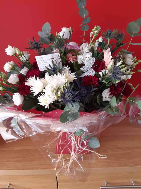 Flower Gift Bouquets and Arrangements - Handtie Bouquet - spider chrysanths, Eustoma, carnations, thistle, foliage, gerbera - burgundy, white, pinks - raffia & red box