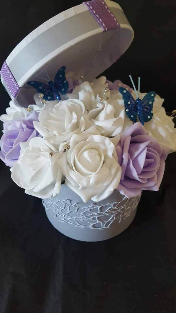 Gifts - Artificial Flower Arrangement - hat box, small Grey & Purple Box, white & lilac Roses, butterfly, web Lace Trim