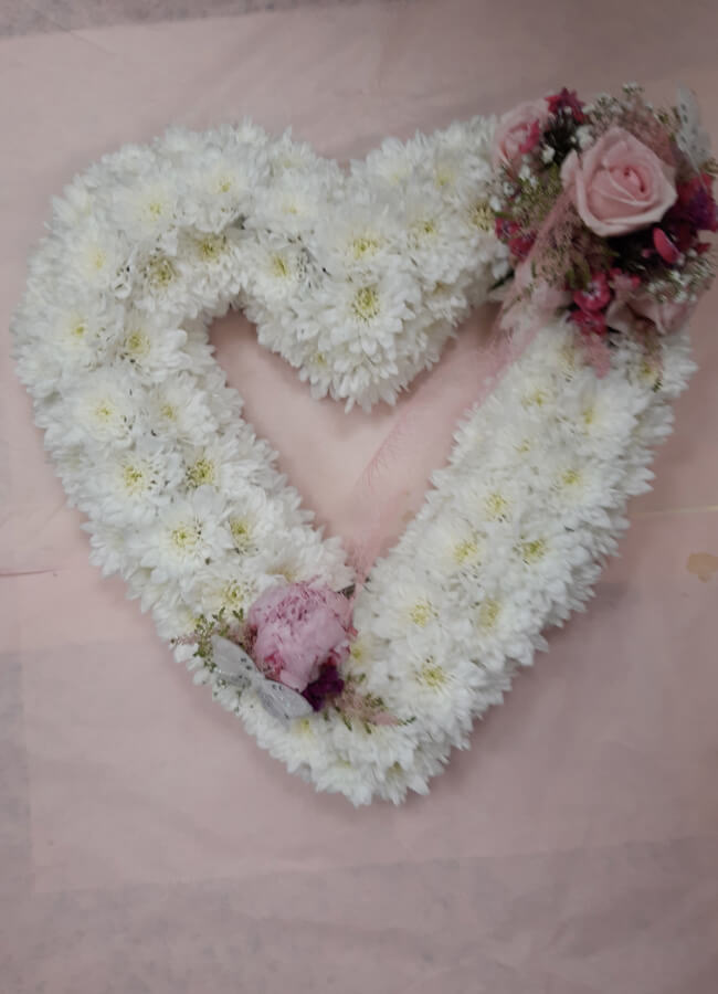 Funeral Arrangements With Timeless Flowers and Treats