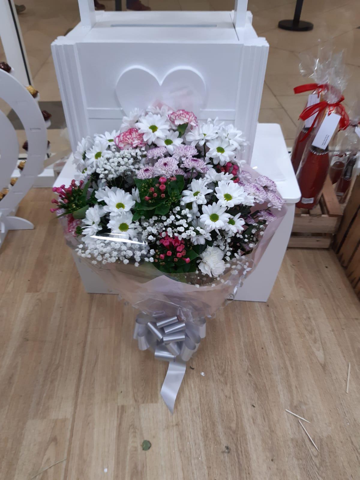 Funeral flat bouquet chrysants bouvardia gyp carnations