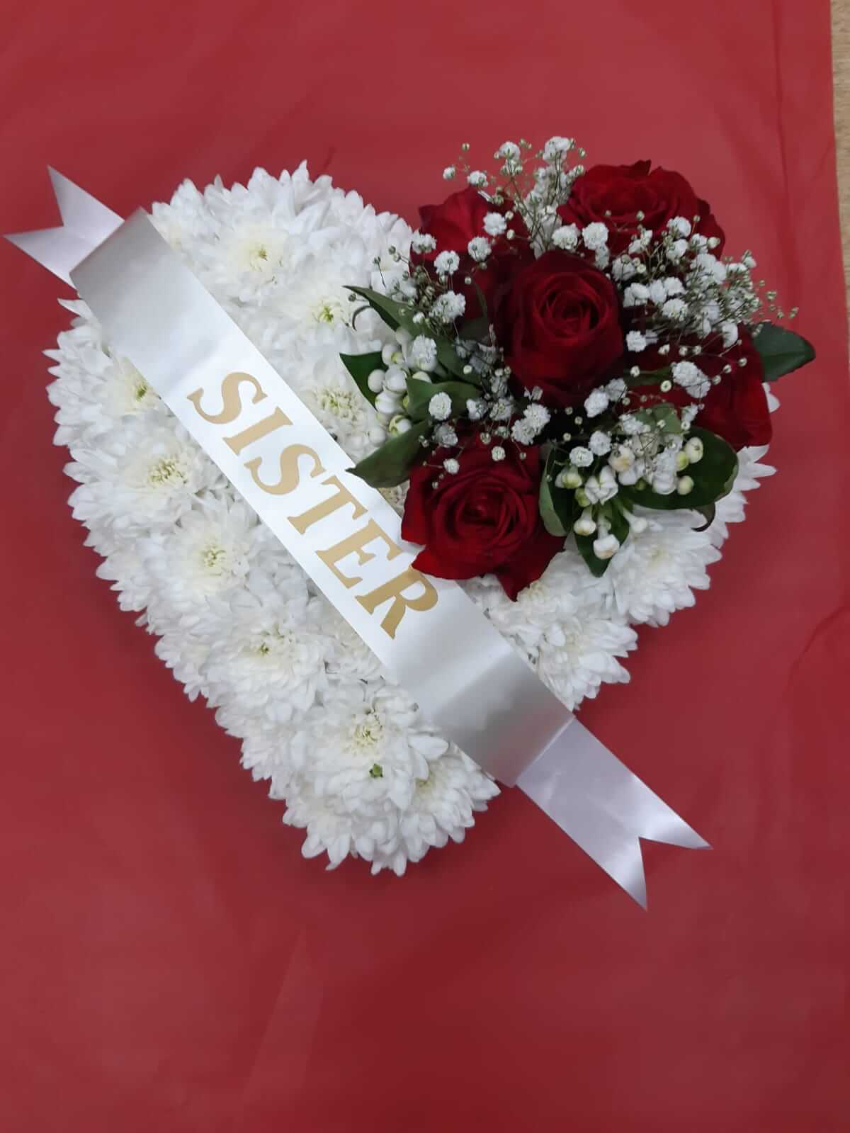 Funeral closed heart white base with red rose spray
